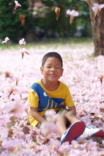 Portrait of smiling boy against plants