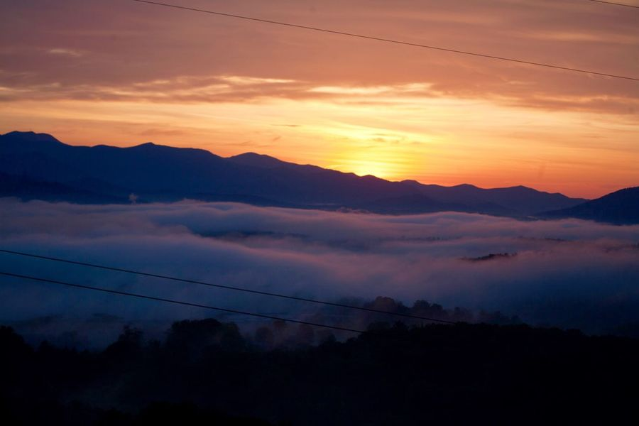 Sunrise in the Smokies as seen from our deck Sunrise Sunset Sky Scenics - Nature Beauty In Nature Cloud - Sky Tranquil Scene Tranquility Mountain Silhouette Idyllic Nature Mountain Range Orange Color No People Environment Landscape Dramatic Sky Non-urban Scene