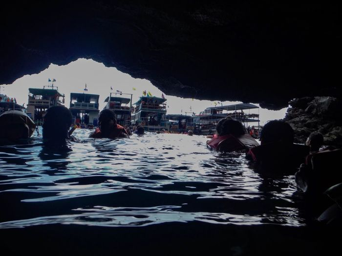 Unseen in Thailand. Morakot Cave (Emerald Cave), Koh Mook, Trang Trip Swimming Boat Family Thailand Unseen Buoy People Island Dive Cave Water Nature Sky Group Of People Wet City Real People Waterfront Travel Outdoors Architecture Lifestyles Sea Holiday Trip Built Structure Leisure Activity