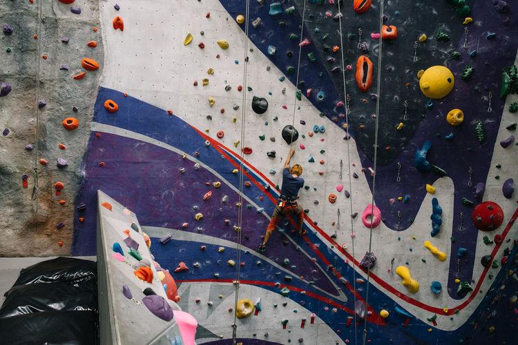 Indoor Rock Climbing Adventure Balance Challenge Climbing Climbing Wall Determination Determination! Exercising Extreme Sports Gym Health Club Healthy Lifestyle Indoor Rock Climbing Indoors  Lifestyle Practicing Rock Climbing Sport Strength