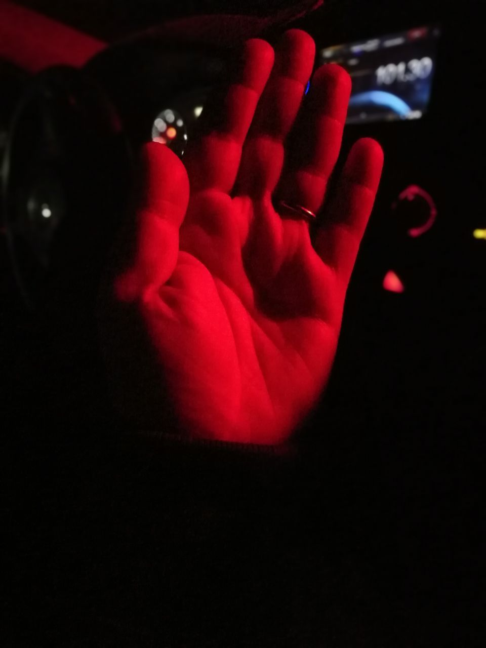 human hand, human body part, hand, real people, one person, body part, red, indoors, dark, human finger, finger, unrecognizable person, close-up, leisure activity, lifestyles, communication, copy space, domestic room, mystery, black background, human limb