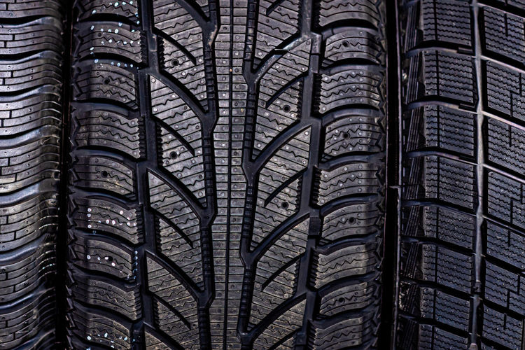 Abstract background with car tire tread texture, close-up