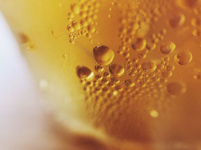 Abstract Backgrounds Bubble Close-up Drink Drop Extreme Close-up Food And Drink Freshness Full Frame Indoors  No People Non-alcoholic Beverage Purity Refreshment Selective Focus Soda Still Life Water Wet Yellow