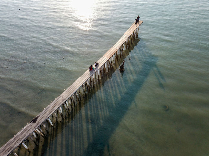 High angle view of people on pier at sea