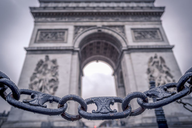 Close-up of chain against arc de triomphe