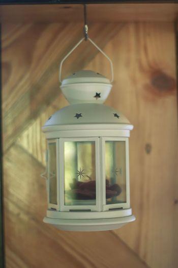 Close-up of illuminated lantern hanging on wall