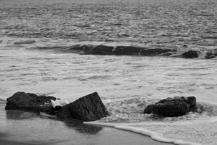 Breaking on the Blocks Surf Beach Beauty In Nature Black And White Blackandwhite Concrete Land Motion Nature Scenics - Nature Sea Solid Tranquility Water Waterfront Wave