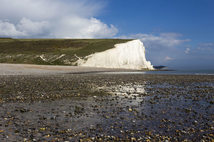 Pebble beach and the Seven Sisters Cliffs at Cuckmere Haven, Seaford, East Sussex, England, United Kingdom Beauty In Nature Blue Chalk Cliffs Challenge Clouds Coastline Country Cuckmere East Sussex England Eroded Europe Landscape Pebble Beach Pebbles People Seaford Seascape Seven Sisters Seven Sisters Cliffs Shoreline United Kingdom Water White White Cliffs