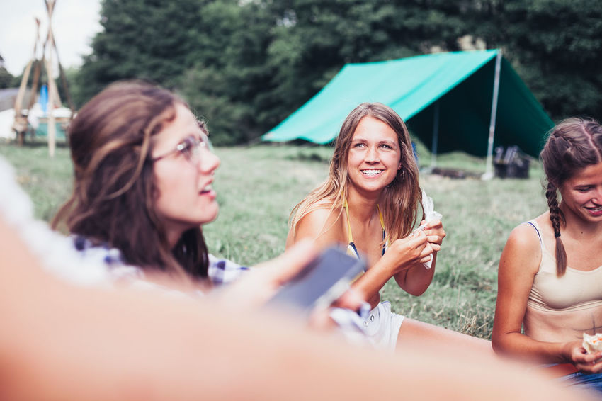 Adult Bonding Emotion Friendship Group Of People Happiness Leisure Activity Lifestyles Outdoors People Portrait Real People Selective Focus Smiling Summer Togetherness Women Young Adult Young Women