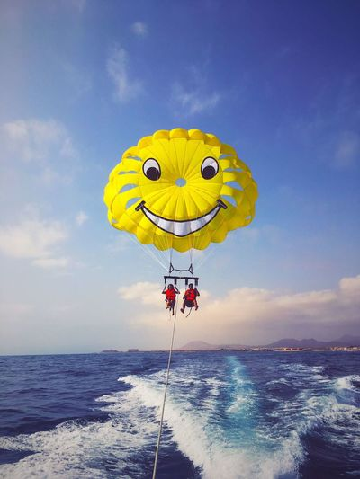 Breathing Space Smile Sea Sea And Sky Happy Smiley Parasailing Parachute Day Yellow Outdoors Sunlight Shore Beach Low Angle View Adrenaline Adventure Two People Flying Paint The Town Yellow Been There. Done That. Lost In The Landscape Be. Ready.