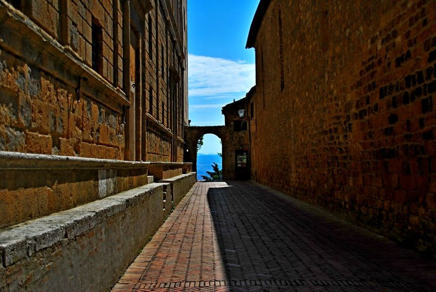 Pienza Italy Architecture Building Exterior Built Structure City Day Men One Person Outdoors People Real People Rear View Sky Sunlight The Way Forward