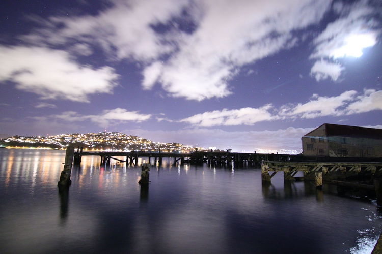 Architecture Building Building Exterior Built Structure City Cloud - Sky Crowd Day Group Of People Large Group Of People Nature Outdoors Pier Real People Reflection Silhouette Sky Water Waterfront Wooden Post