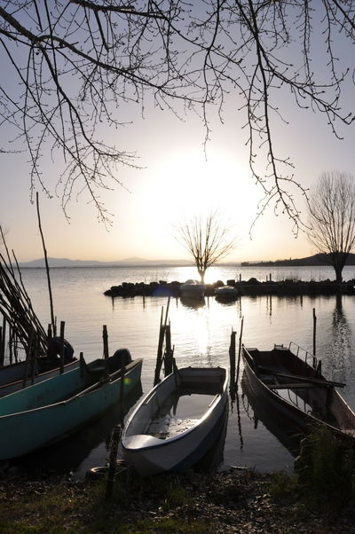Reflection Sunset Nautical Vessel Sky Outdoors Sea Moored No People Travel Destinations Tree Nature Tranquility Water Vacations Scenics Horizon Over Water Beauty In Nature Gondola - Traditional Boat Day Trasimenolake