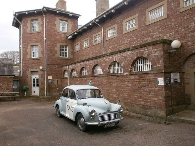 Architecture Building Building Exterior Built Structure Car Land Vehicle Morrisminor Old Outdoors Policecar Prison Transportation Window