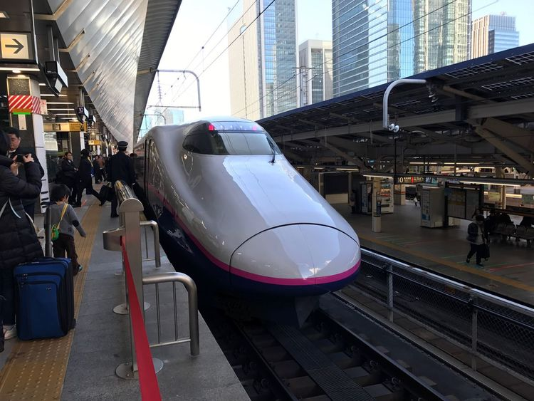 at a Shinkansen Platform of Tokyo Station Tokyo Japan . Architecture Transportation Building Exterior Real People Travel Day Mode Of Transport Public Transportation City Large Group Of People Men Outdoors Modern Skyscraper Sky People Mother And Son Let's Go. Together.