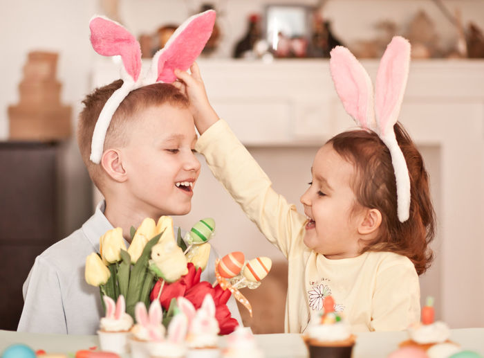 Cute kids wearing rabbit costume at home
