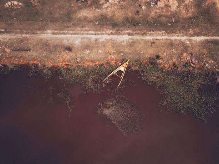 High Angle View Of Damaged Boat On Lake