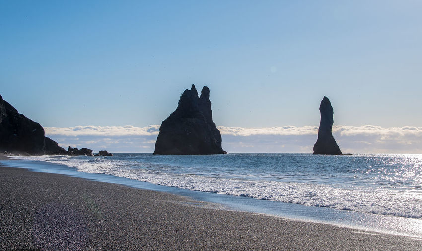 Black sand beach at Iceland Iceland Nature Rock Beach Beauty In Nature Black Sand Beach Blue Clear Sky Copy Space Horizon Horizon Over Water Idyllic Land Nature No People Outdoors Rock Sand Scenics - Nature Sea Sky Stack Rock Tranquil Scene Tranquility Water