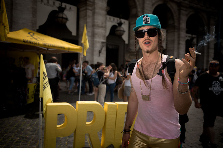 PRIDE The Portraitist - 2019 EyeEm Awards The Street Photographer - 2019 EyeEm Awards My Best Photo Prideparade Gay Portrait Of A Man  Portrait Photography Portrait Spot Light  Urban Living Urbanphotography Urban Street Life Street Light Rainbow Colors Smoking Issues Smoking Smoke Photojournalism Photography Flash LGBT Rainbows Lgbt Pride Lgbt Pride Parade Pride Roma Gay Pride Street Photography Street Streetphotography Outdoors Men Group Of People Yellow Standing Casual Clothing Women Focus On Foreground Glasses Leisure Activity Waist Up Lifestyles Fashion Sunglasses Day People Incidental People Architecture Real People