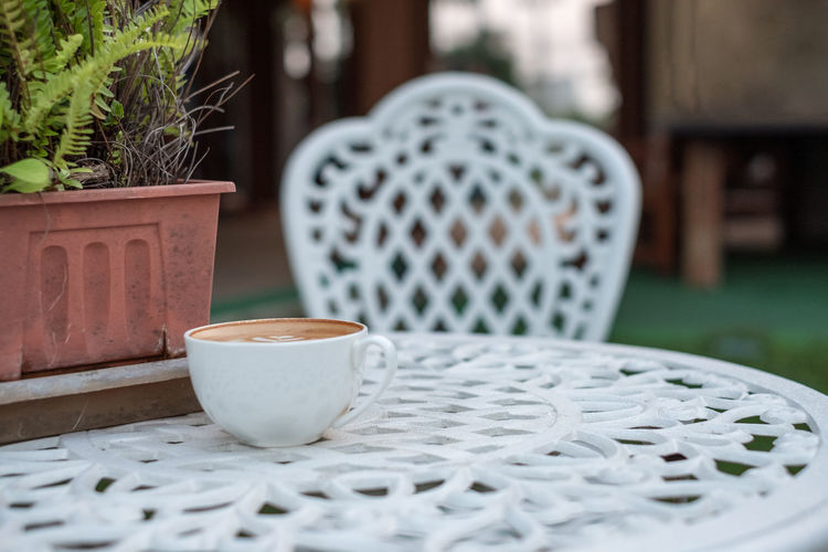 Aroma Art Background Beautiful Beverage Breakfast Brown Cafe Cappuccino Ceramic Chair Coffee Cozy Cream Cup Design Desk Drink Espresso Flower Foam Food Freshness Froth Glass Hot Latte Leaf Lifestyle Milk Morning Plant Pot Relaxation Retro Shape Style Sweet Table Tasty Texture Top Vacation Vase Vintage White Wood