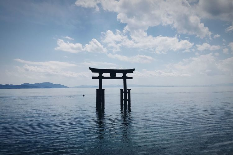 Torii gate in biwa lake against sky