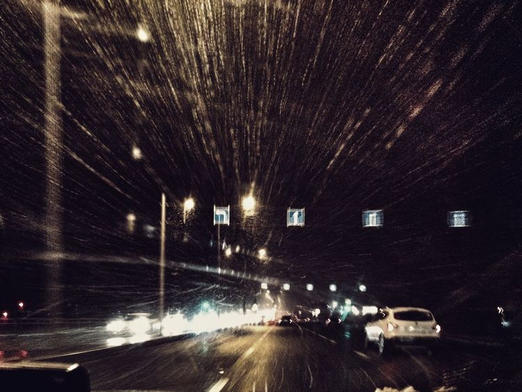 First snow Night Illuminated Transportation Car Road Outdoors No People City Road Sign Road Trip Road Arrows Snowing Moving Fast Direction Moving Forward  Connected By Travel Moto X2 The Week On EyeEm Window Mobility In Mega Cities Creative Space