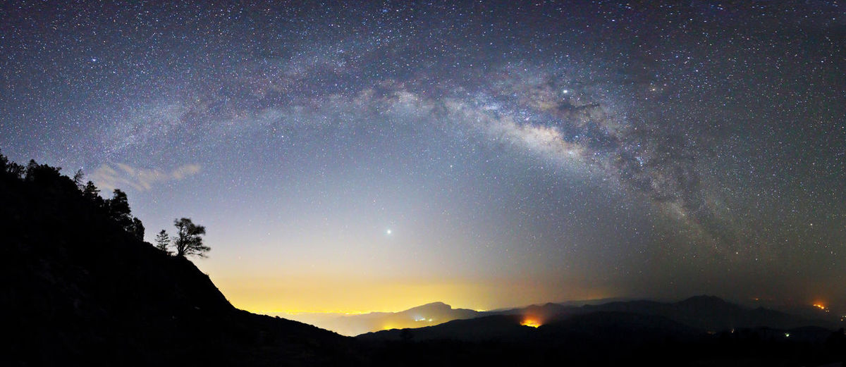 Long exposure photograph of Panorama Milky Way Galaxy with mountain at Doi inthanon Chiang mai, Thailand Star - Space Space Night Astronomy Sky Scenics - Nature Galaxy Beauty In Nature Tranquil Scene Tranquility Nature Milky Way Star No People Mountain Idyllic Silhouette Star Field Infinity Constellation Outdoors Panorama Long Exposure Milky Way Galaxy Atmosphere Dark Dawn Landscape Nebula Nightscape Outdoor Scenics Science Starry Summer Travel Universe Blue Yellow
