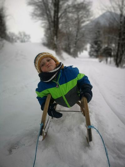Full length of child on snow covered field