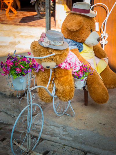 High angle view of stuffed toy with flowers outdoors