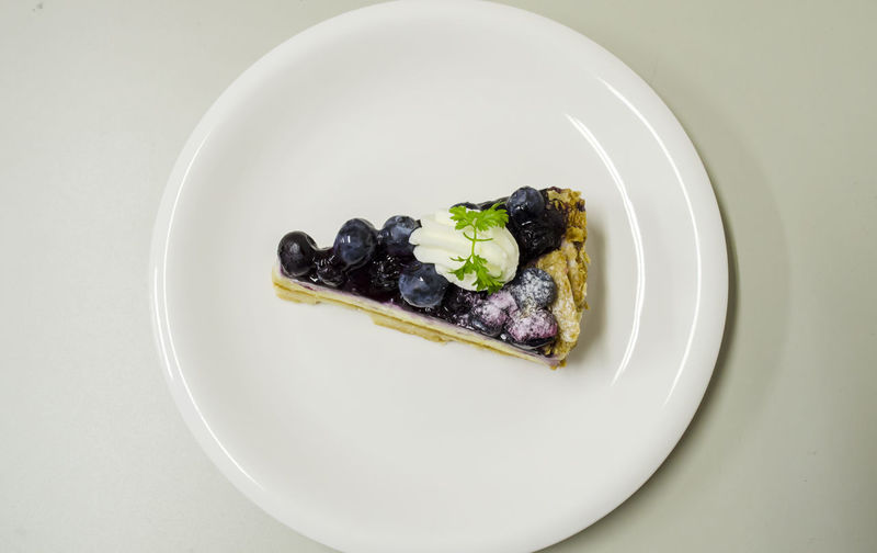Delicious Blueberry Cheese Pie Black Olive Blueberry Blueberry Cheesecake Blueberry Pie Blueberrycheesecake Close-up Day Directly Above Food Food And Drink Freshness Healthy Eating High Angle View Indoors  Indulgence No People Olive Plate Ready-to-eat Studio Shot White Background