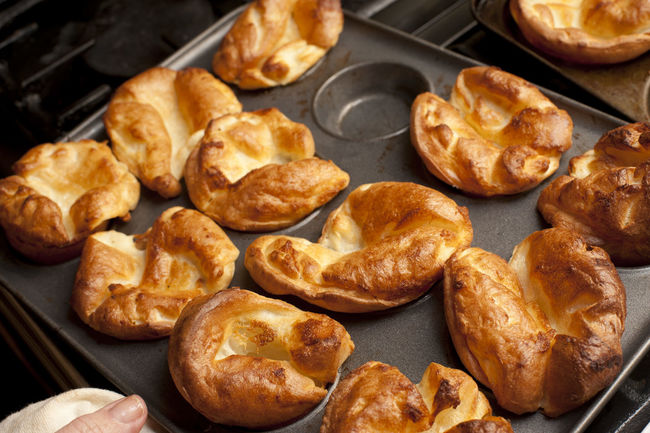 Traditional English Yorkshire puddings made from batter in a baking tray waiting to accompany a meal of roast beef Abundance Baked Batter Cooking Crust Food Food And Drink Fresh Golden High Angle View Indoors  Indulgence Kitchen Preparation  Tasty Tastyyorkshire Pudding Tray Yorkshire Pudding