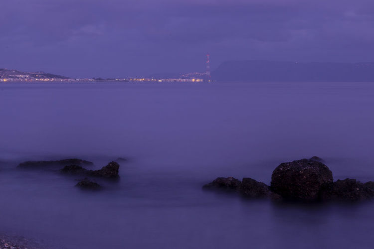 Water Sea Rock Beauty In Nature Tranquility Solid Rock - Object Sky Scenics - Nature Nature Night Tranquil Scene No People Purple Long Exposure Dusk Illuminated Beach Outdoors