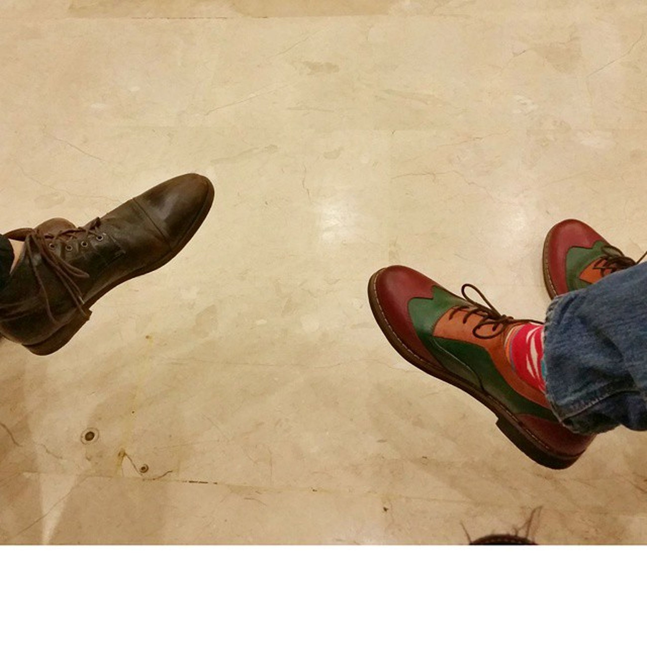 low section, shoe, person, lifestyles, footwear, standing, human foot, leisure activity, men, jeans, casual clothing, high angle view, personal perspective, canvas shoe, flooring, pair