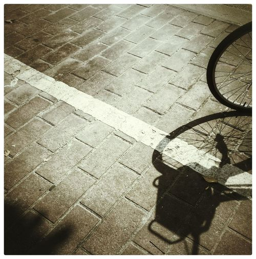 Bicycle Blackandwhite Day No People Outdoors Shades Of Grey Shadow Shadows & Lights Stone Tile