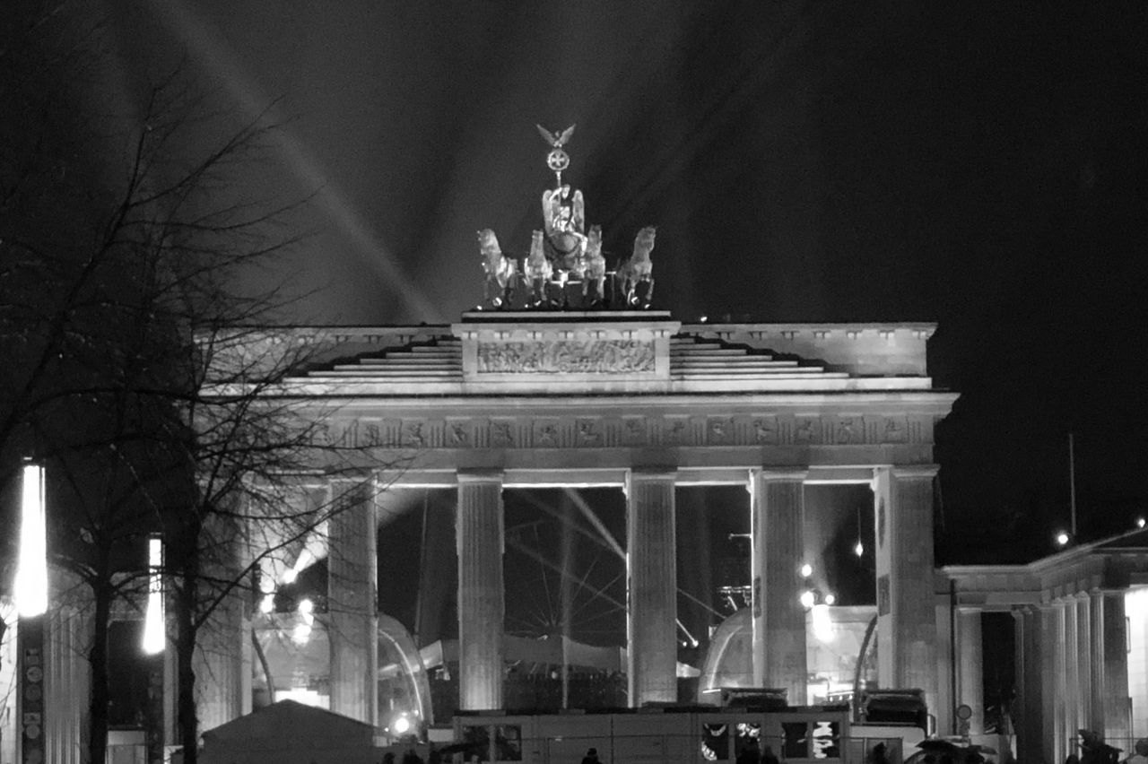 architecture, night, sculpture, statue, travel destinations, built structure, illuminated, tourism, art and craft, building exterior, travel, representation, city, human representation, sky, low angle view, nature, no people, architectural column, city gate