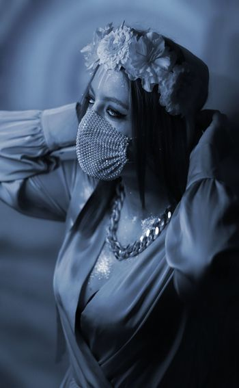 Portrait of young woman wearing mask