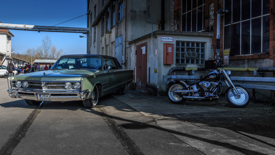Chrysler 300 & Harley-Davidson Mode Of Transportation Transportation Land Vehicle Car Motor Vehicle Building Exterior Architecture City Built Structure Road Street Vintage Car Building Retro Styled Damaged Day Old Outdoors Nature Ruined Chrysler Harley Davidson