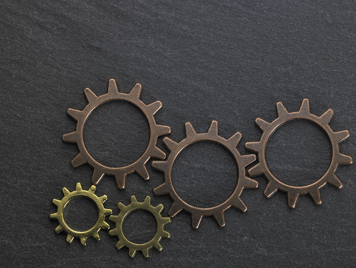 Close-Up Of Gears On Black Table