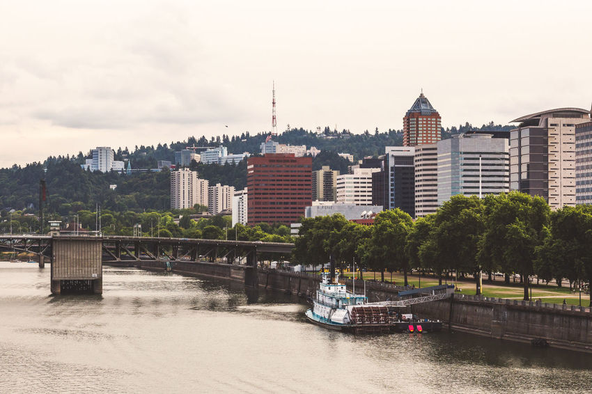Downtown buildings and the Willamette River in Portland, Oregon. River boat in foreground. Architecture City River Building Waterfront Day Bridge Travel Cityscape Portland Portland, OR Portland Oregon Portlandia PortlandOregon