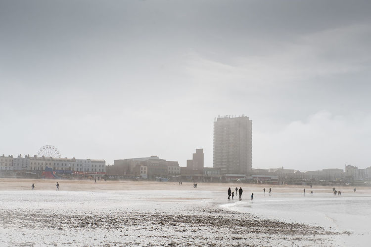 The Beach, Margate, Kent, on a cloudy day. Beach Day Incidental People Group Of People Outdoors Cloud - Sky Water Travel Destinations Sky Land Sand Nature Margate Kent Uk Moody Cloudy Day Sands Seaside Coast Walk Walking Architecture