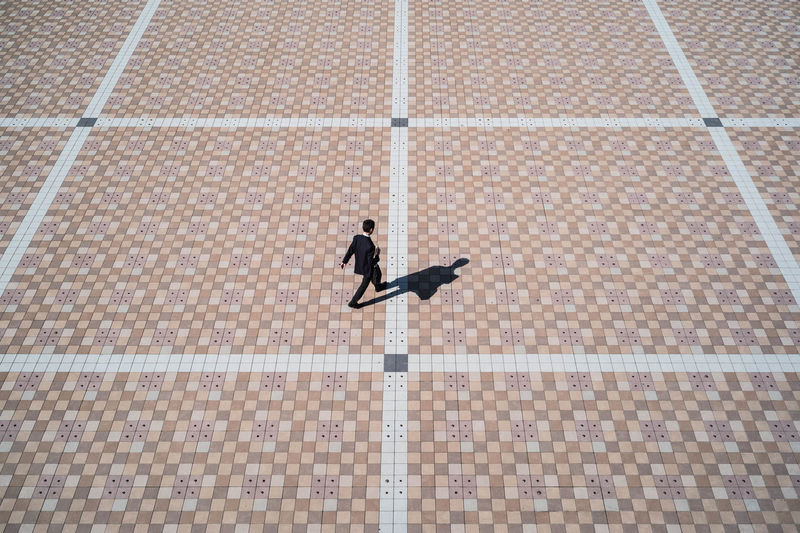 High angle view of woman walking on swimming pool