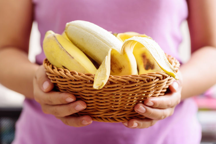 Peeled banana fruit in a basket holding by hand, healthy eating Banana Basket Bunch Cuisine Diet Eating Food Fresh Freshness Front View Fruit Giving Gourmet Hand Health Healthy Holding Ingredient Natural Nature Nutrition Organic Peel Peeled Ripe Sweet Tropical Vegetarian Vitamin Yellow Midsection Food And Drink Close-up Healthy Eating Wellbeing Human Hand