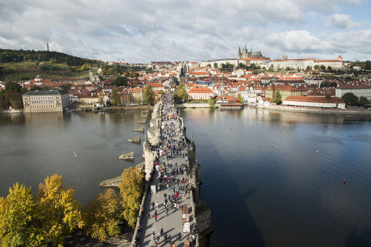 View of Charles bridge (Karluv Most) from the height. Ancient Charles Bridge Cityscape Czech Famous Karlův Most Prague Sunny Travel Trip Architecture Autamn City Cityscape Day Destination High Angle View Historical Landmark Medieval People River Sky Vlatava Water