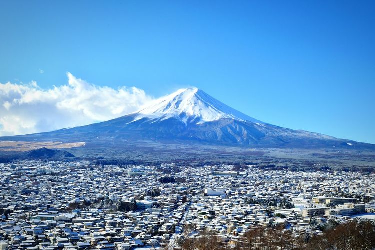 Residential District By Mount Fuji Against Sky