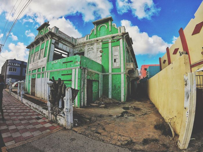 Low angle view of abandoned buildings against sky