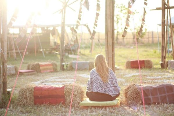 Morning praise in Thailand at Wonderfruit Relaxation One Person Rear View Sunlight Sitting Outdoors Nature Wonderfruit Spirituality Peaceful Serene