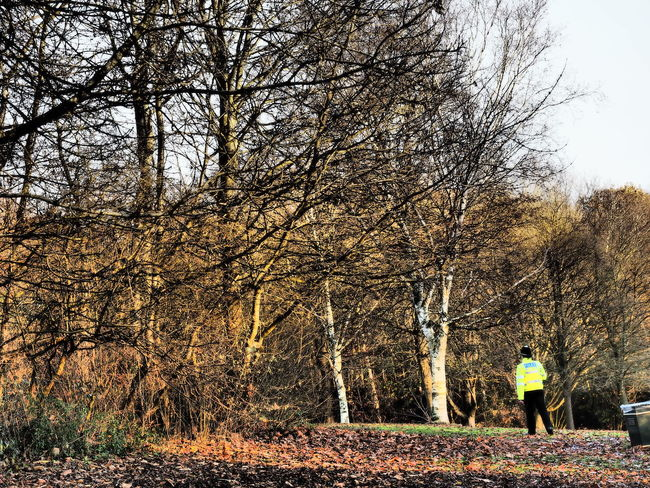 The chase Chasing A Burglar Day Time Theft Hi Viz Copper On The Beat Policeman Through The Woods Winter Winter Afternoon