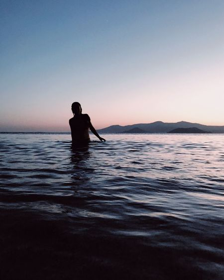 I'll figure out Water Sky One Person Sea Sunset Beauty In Nature Men Silhouette Leisure Activity Tranquility Outdoors The Great Outdoors - 2018 EyeEm Awards The Traveler - 2018 EyeEm Awards Summer Sports HUAWEI Photo Award: After Dark
