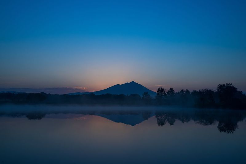 before dawn Water Reflection Sky Scenics - Nature Lake Beauty In Nature Tranquility Idyllic Plant Nature Non-urban Scene Sunset Copy Space Tree Clear Sky Tranquil Scene Mountain Blue No People Outdoors
