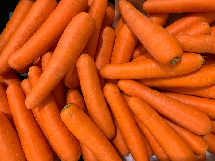 Carrot Root Vegetable Vegetable Food Food And Drink Healthy Eating Orange Color Freshness Large Group Of Objects Full Frame Wellbeing Abundance Still Life Backgrounds No People Market For Sale Retail  Raw Food Organic